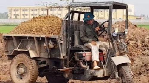 xe công nông chở đất